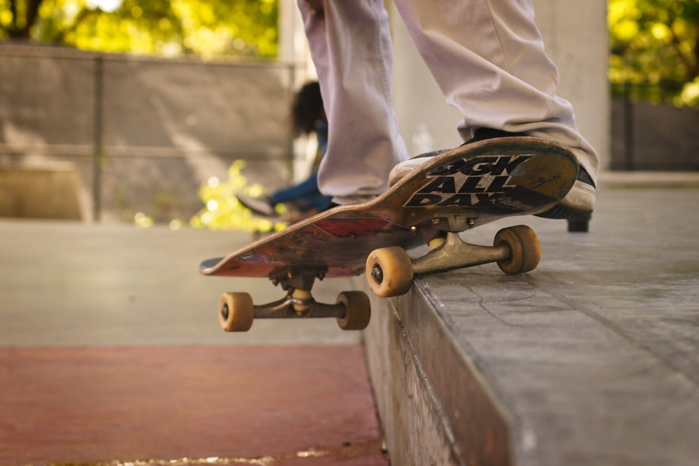 brown wooden skateboard on gray wooden bench