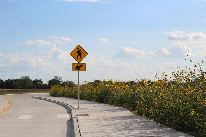 yellow and black road sign