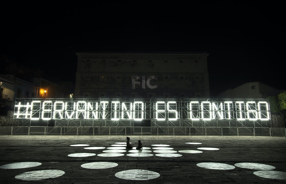 white and black lighted signage during night time