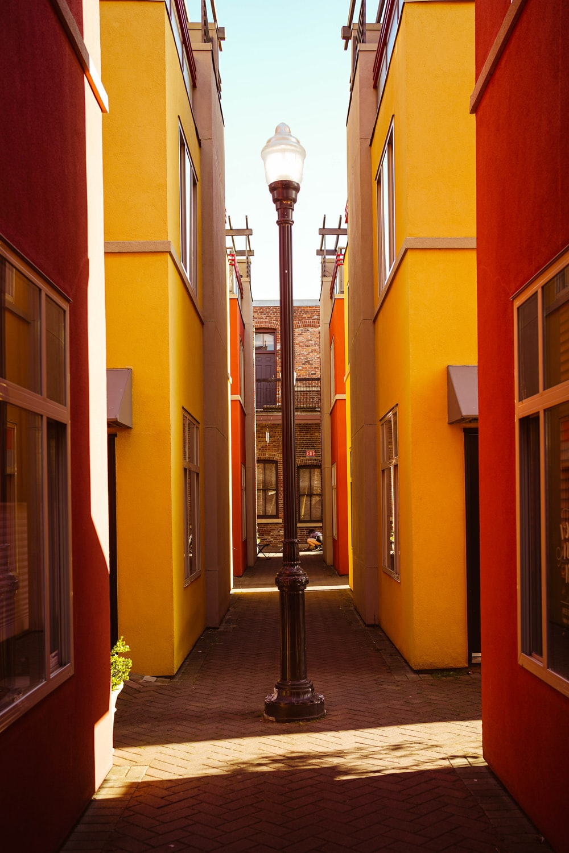 black street light near orange concrete building