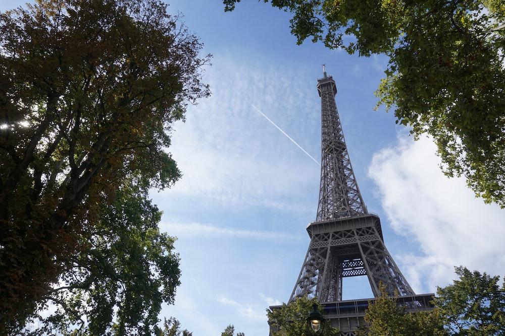 eiffel tower under white clouds during daytime