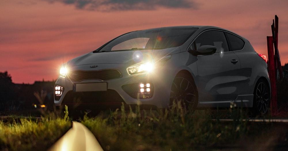 silver honda car on green grass field during sunset