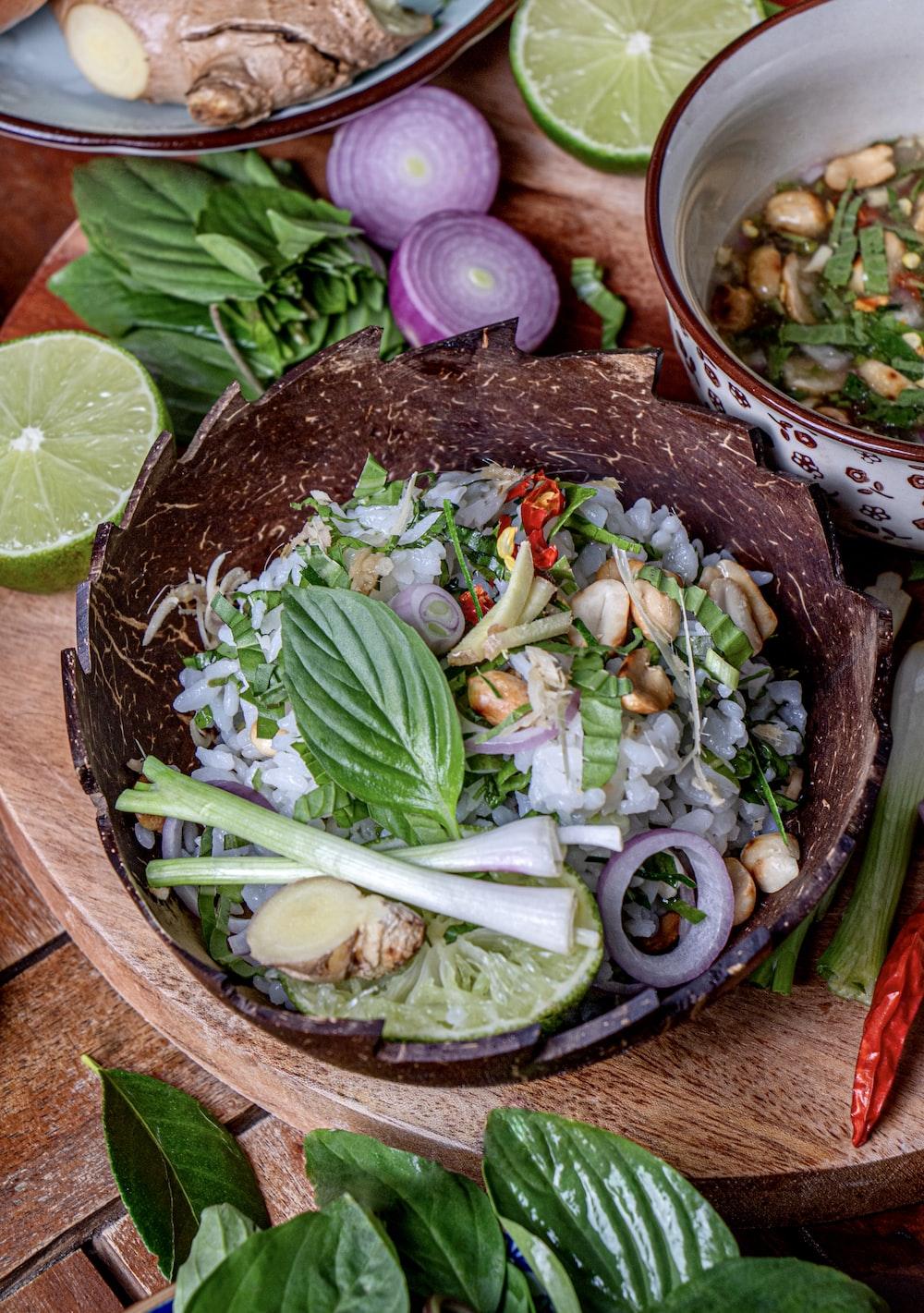 vegetable salad on brown wooden bowl