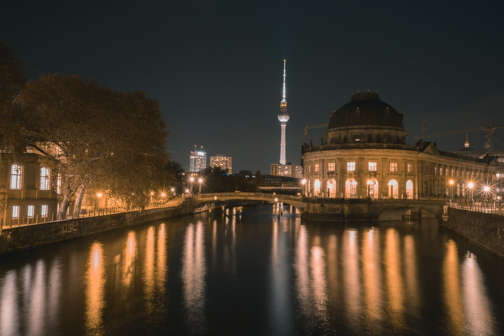 white dome building near body of water during night time