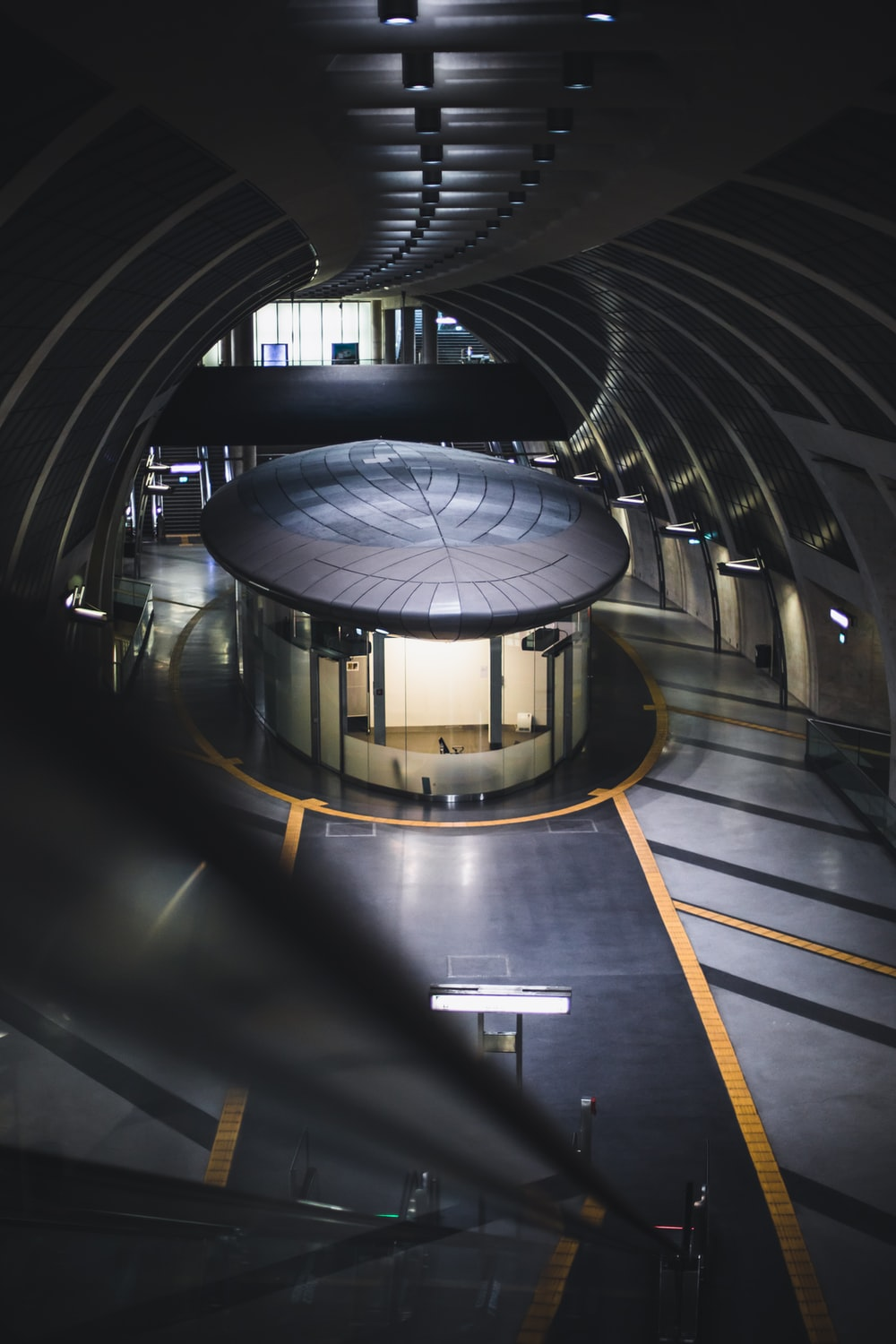 gray and black tunnel with white ceiling