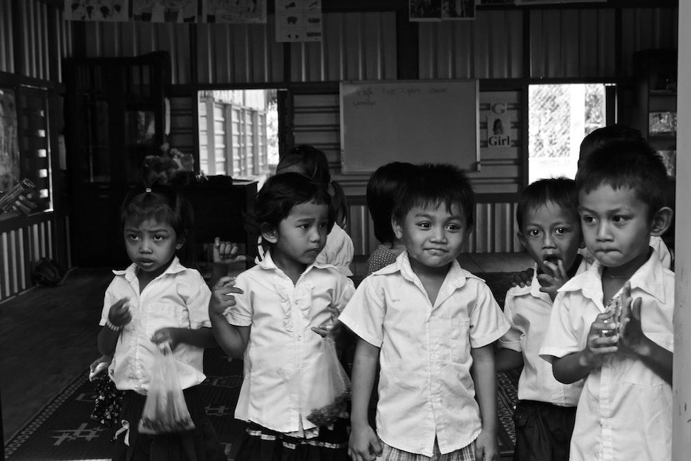 grayscale photo of children in school uniform