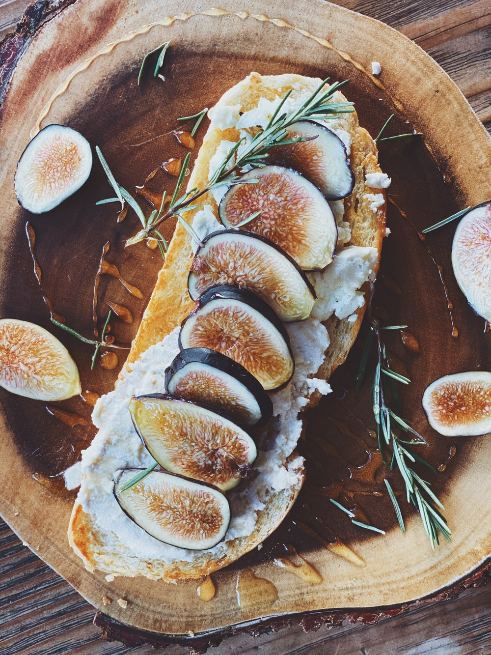 sliced of bread on brown wooden round plate