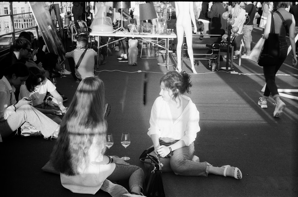 grayscale photo of woman and girl sitting on floor