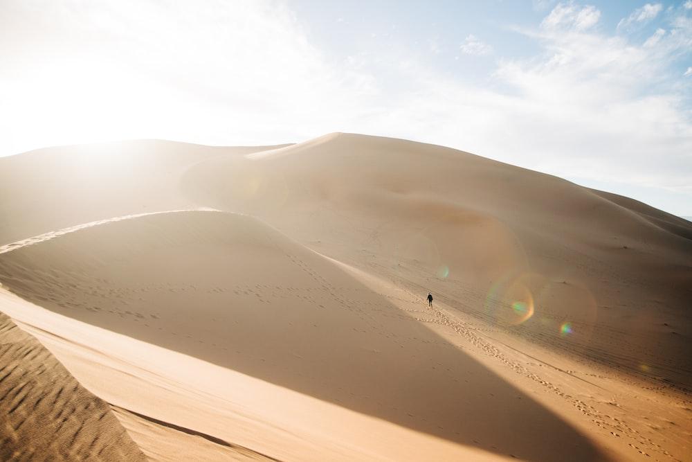 white car on desert during daytime