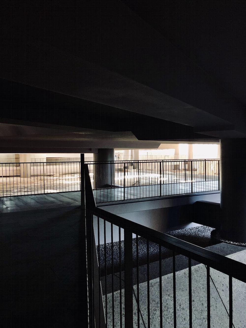 black metal railings near white concrete building