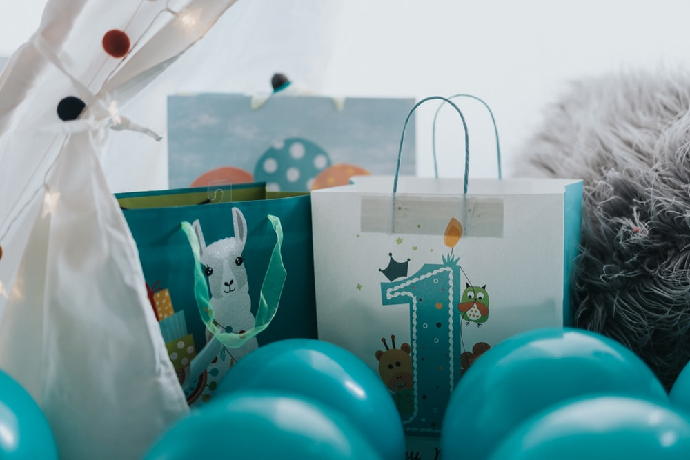 green and white snowman print paper bag