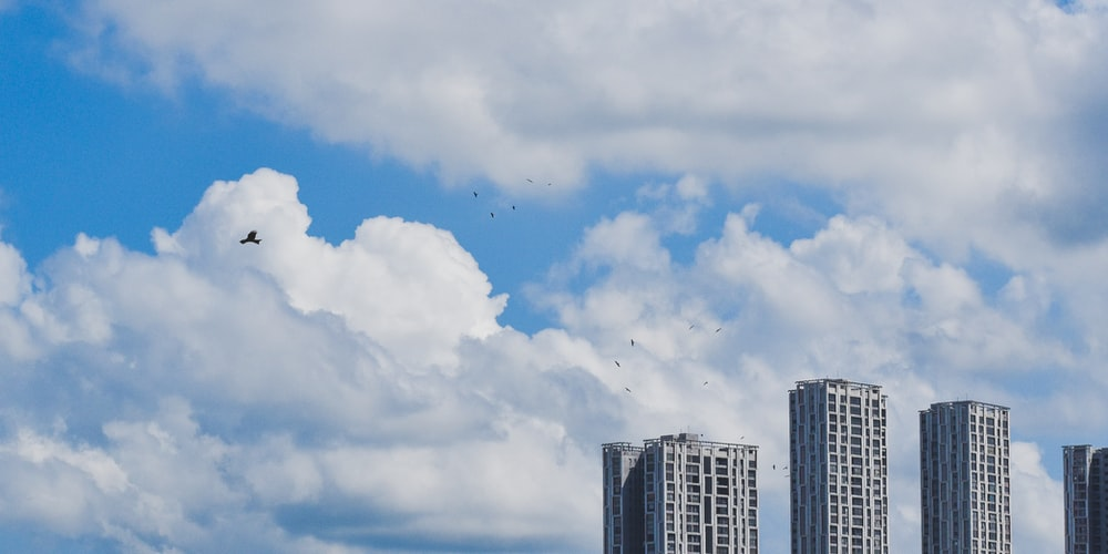 white clouds over city buildings during daytime