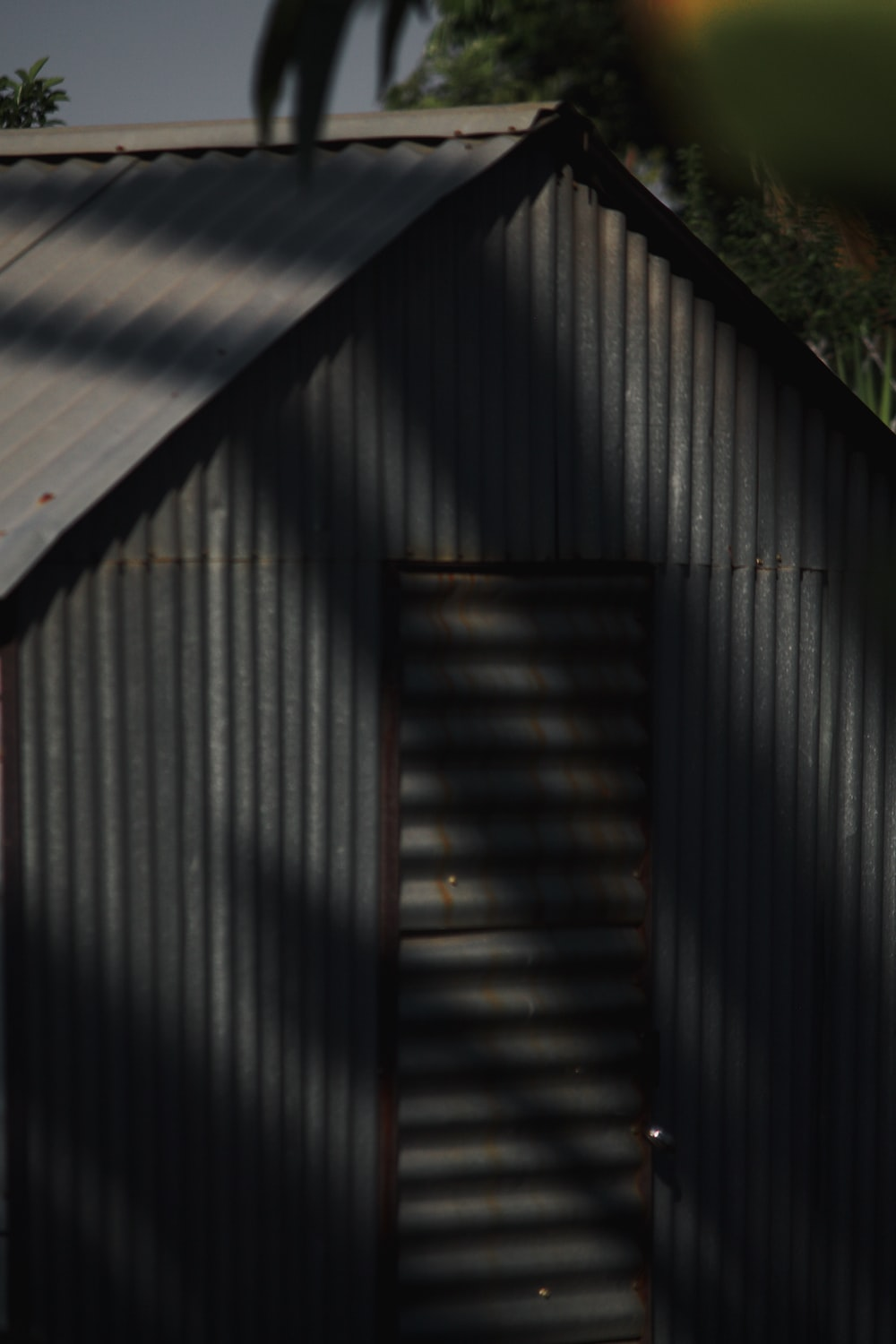 gray wooden house during daytime
