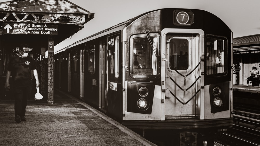 grayscale photo of train on rail road