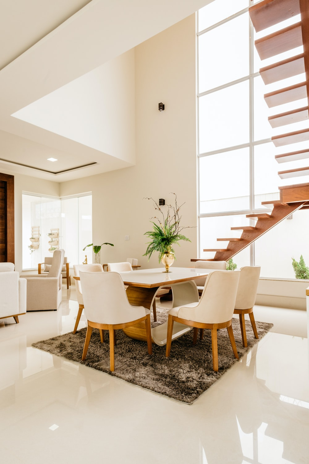 white and brown wooden table and chairs