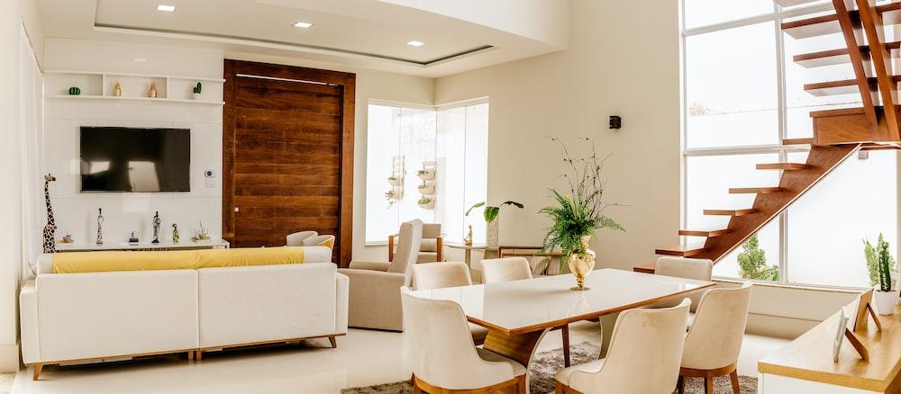 white sofa set near green indoor plant