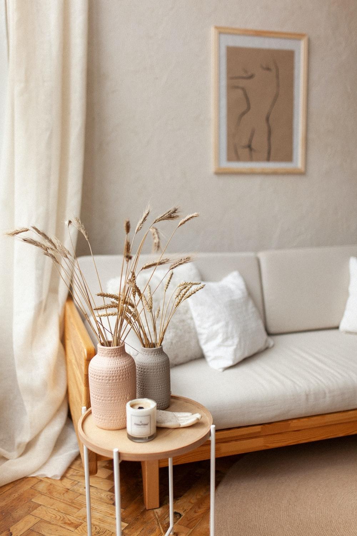 white and brown ceramic mug on white table