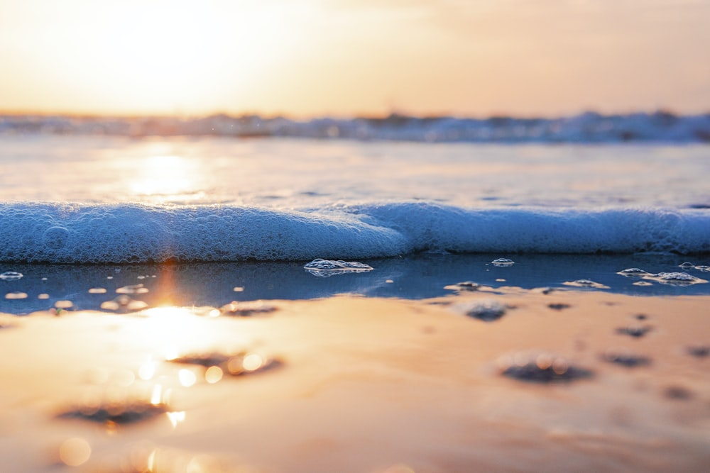 close up photo of sea waves during sunset