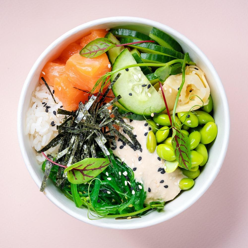 green and orange vegetable on white ceramic bowl