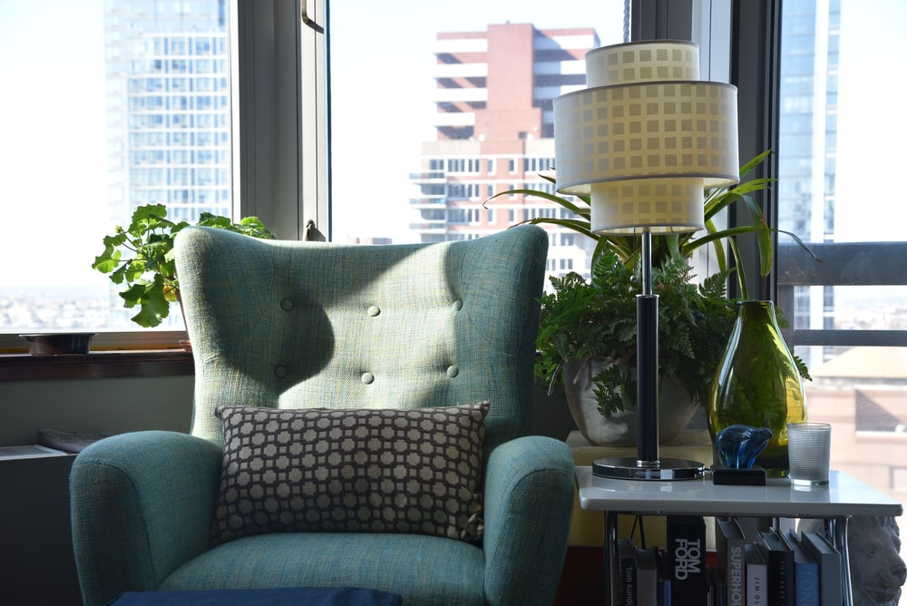 grey and white throw pillow on grey sofa chair
