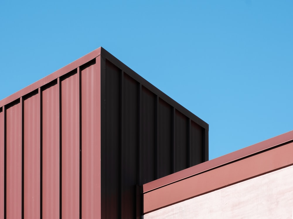 brown wooden fence under blue sky during daytime