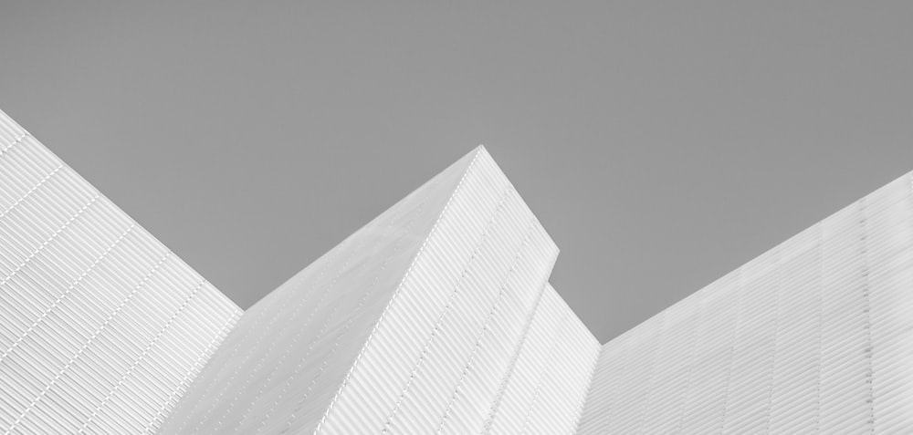 white concrete building in grayscale photography