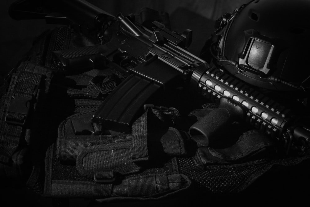 black assault rifle on black textile
