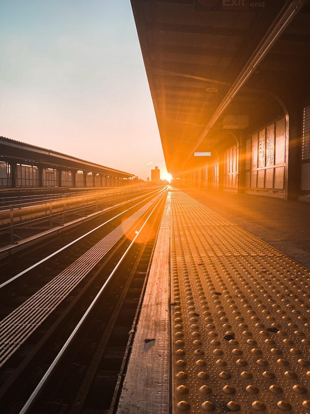 train rail under gray sky