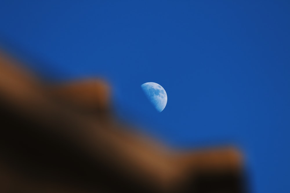white moon in blue sky
