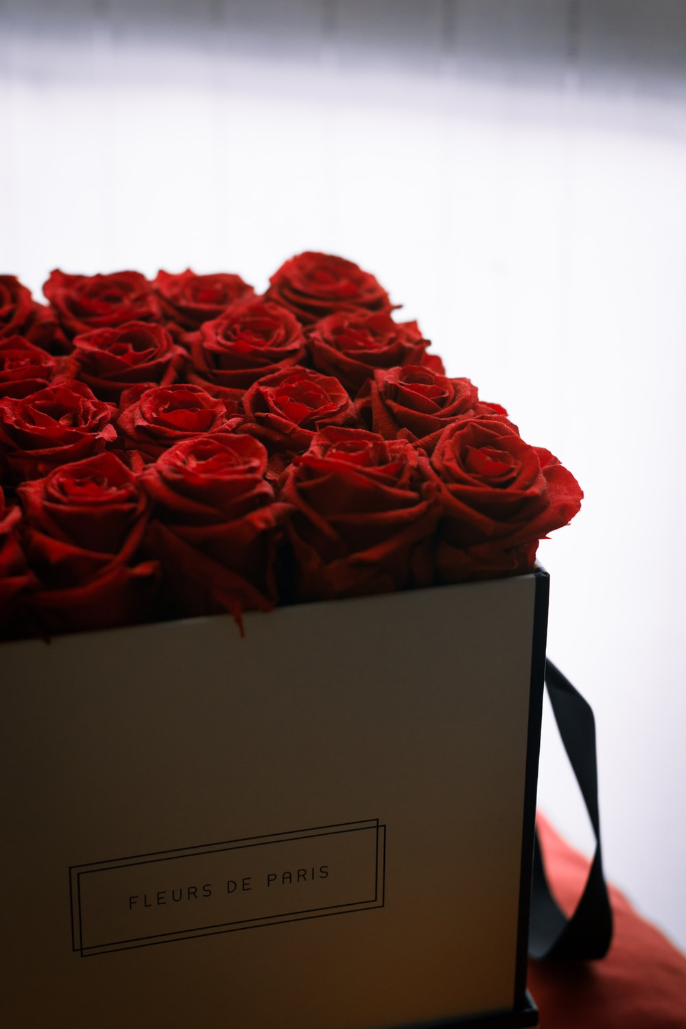 red rose bouquet on brown cardboard box