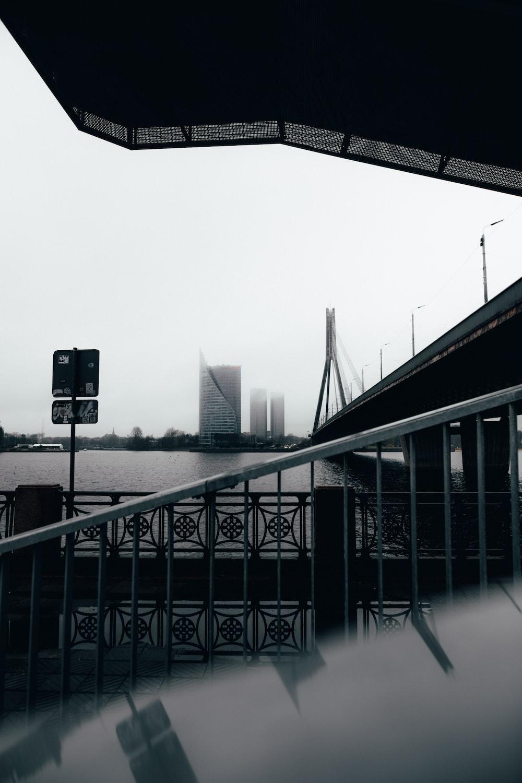 black metal fence near black building during daytime