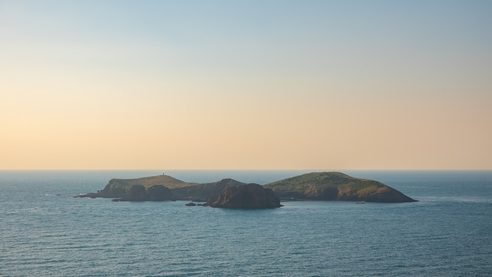 brown and green island on sea during daytime