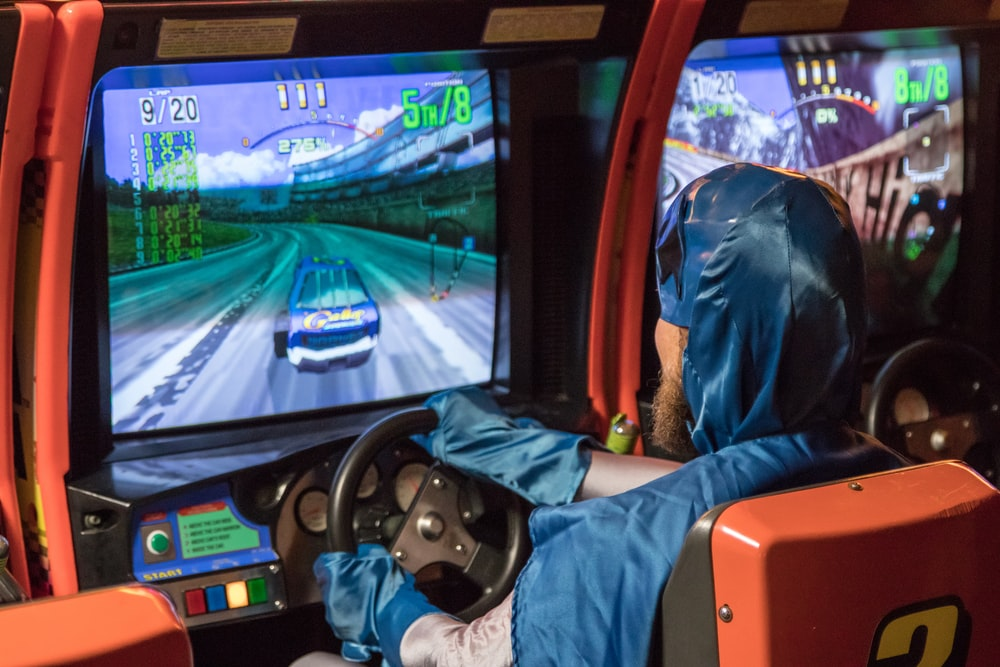man in blue jacket driving car