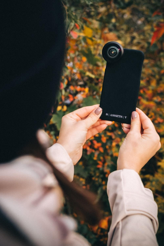 person holding black samsung galaxy smartphone
