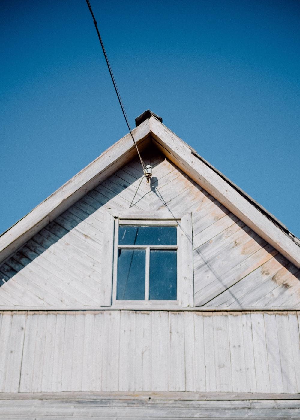 white wooden house under blue sky during daytime