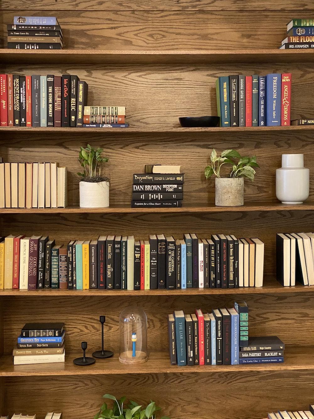 books on brown wooden shelf