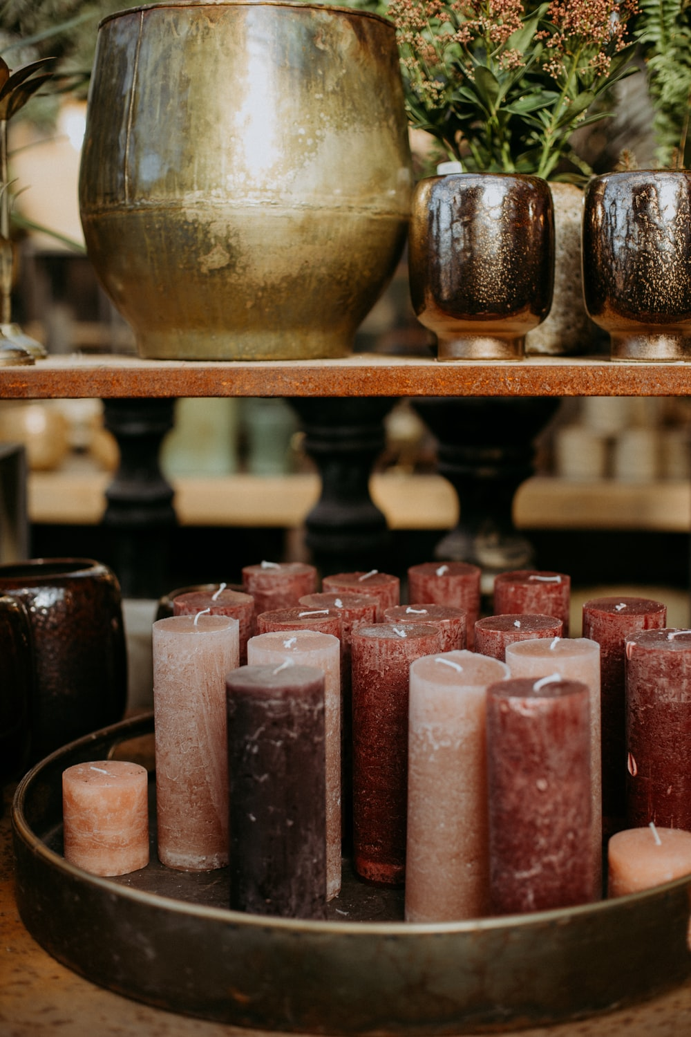 pink and gold candles on brown wooden rack