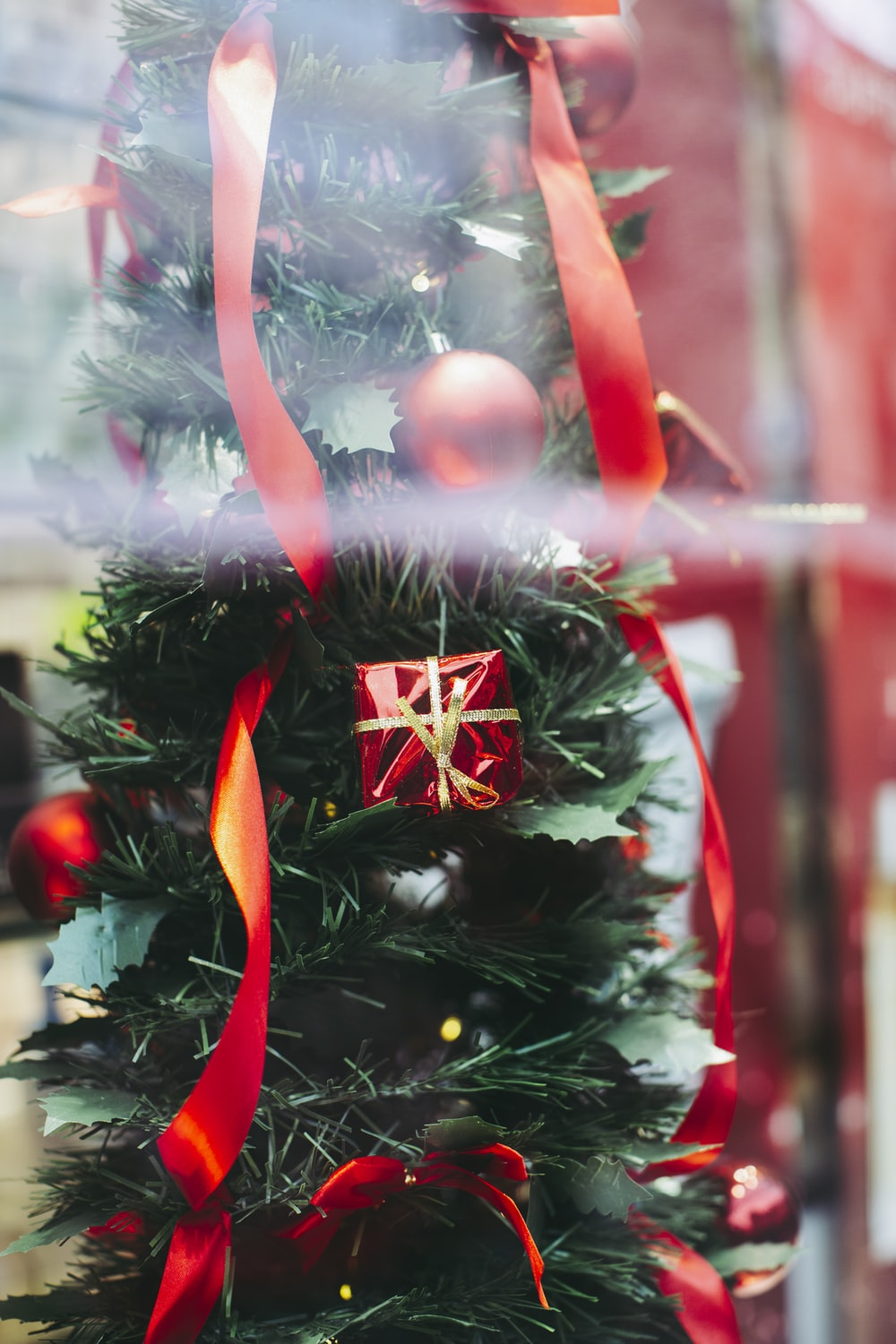 red and white christmas tree with baubles