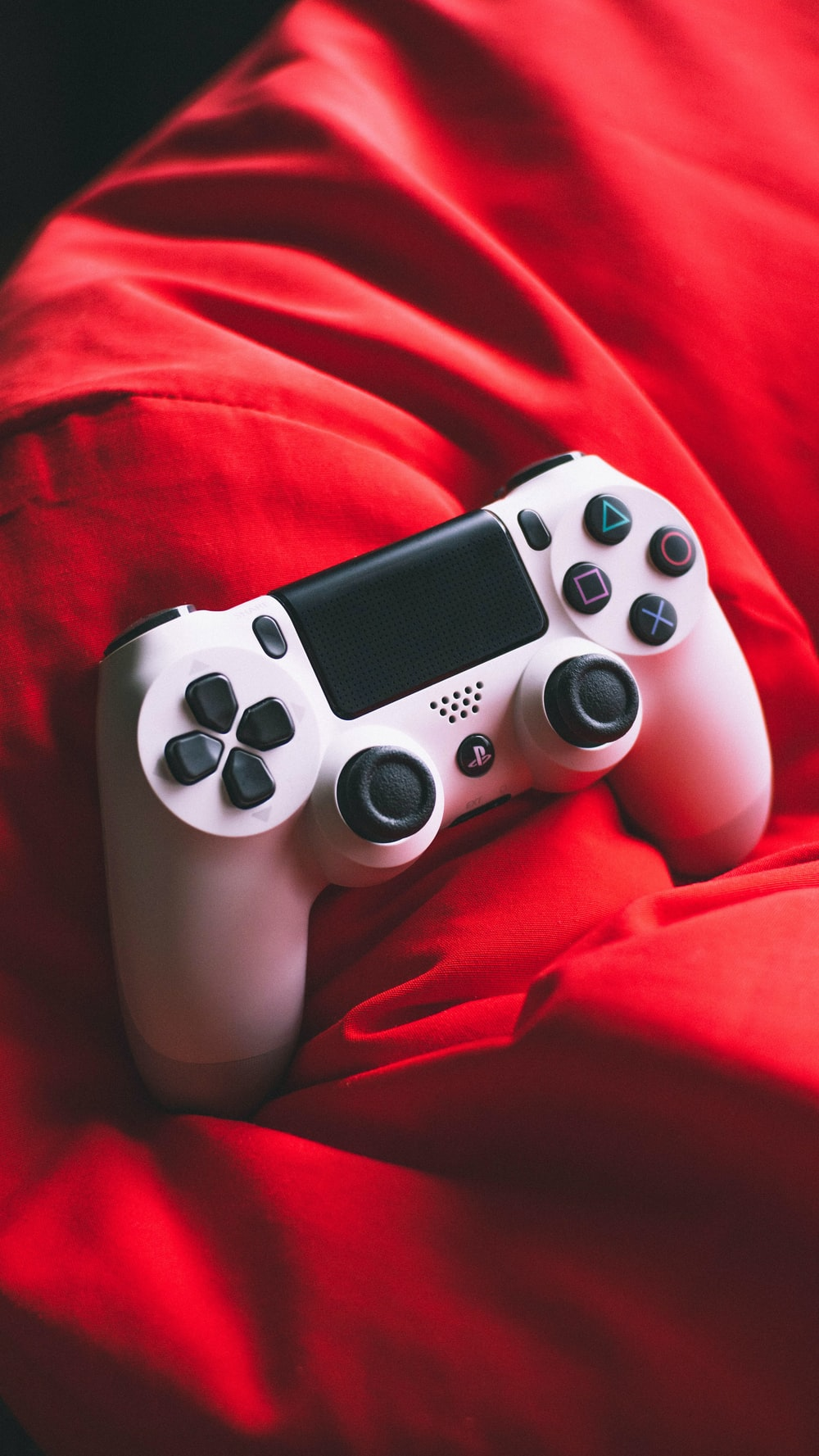 white and black sony ps 4 controller