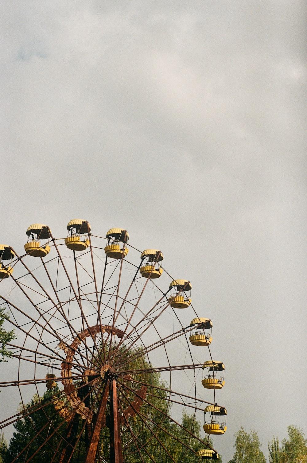 white and yellow ferris wheel under white sky