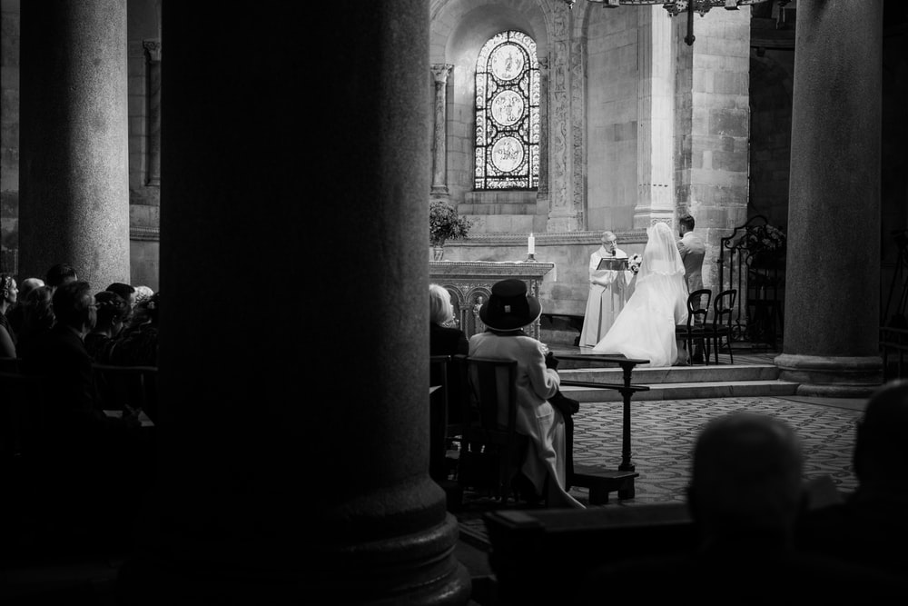 grayscale photo of people in church