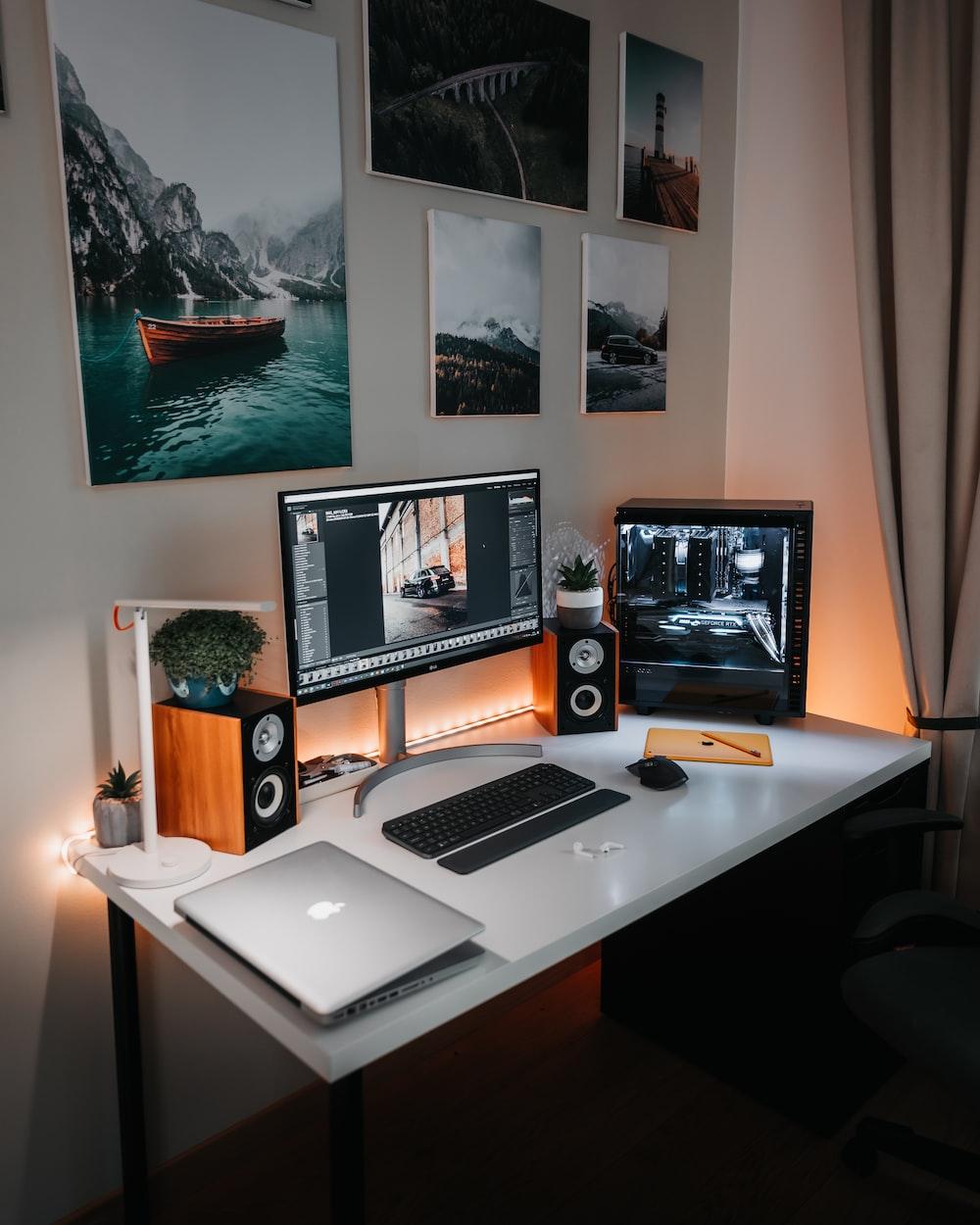 macbook pro on brown wooden desk