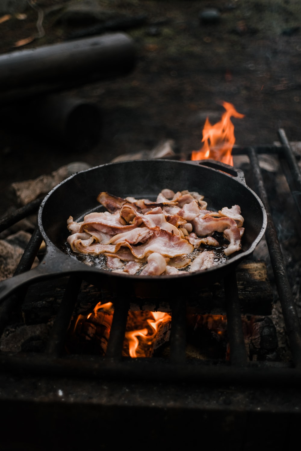 black cast iron pan with fire