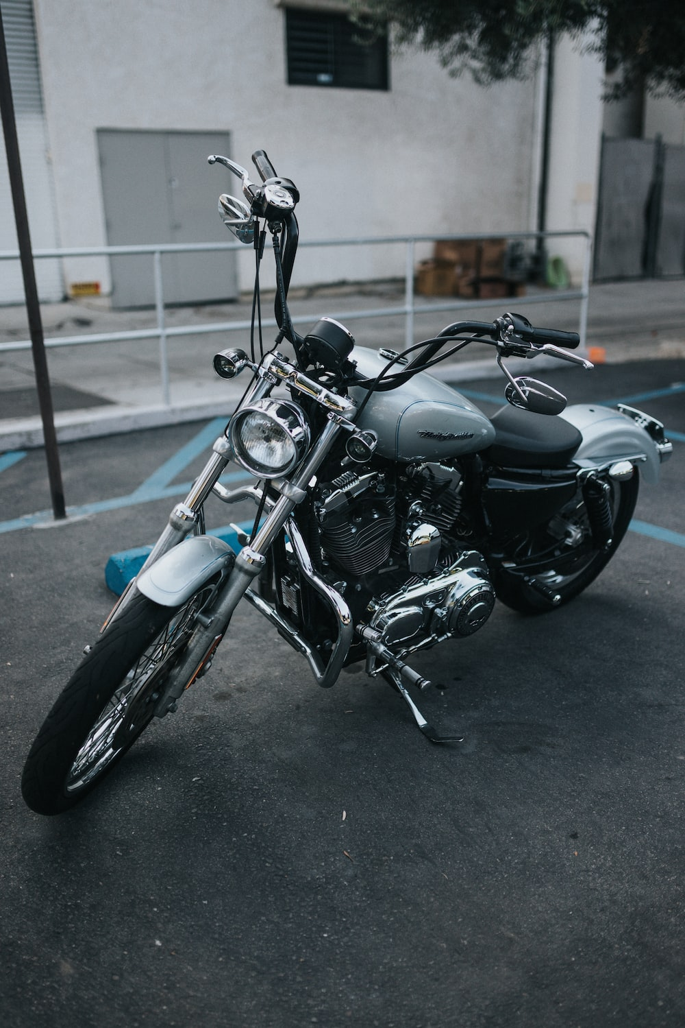 black and blue motorcycle parked on gray concrete floor during daytime