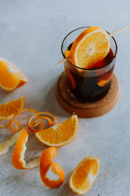 sliced orange fruit on brown wooden round plate