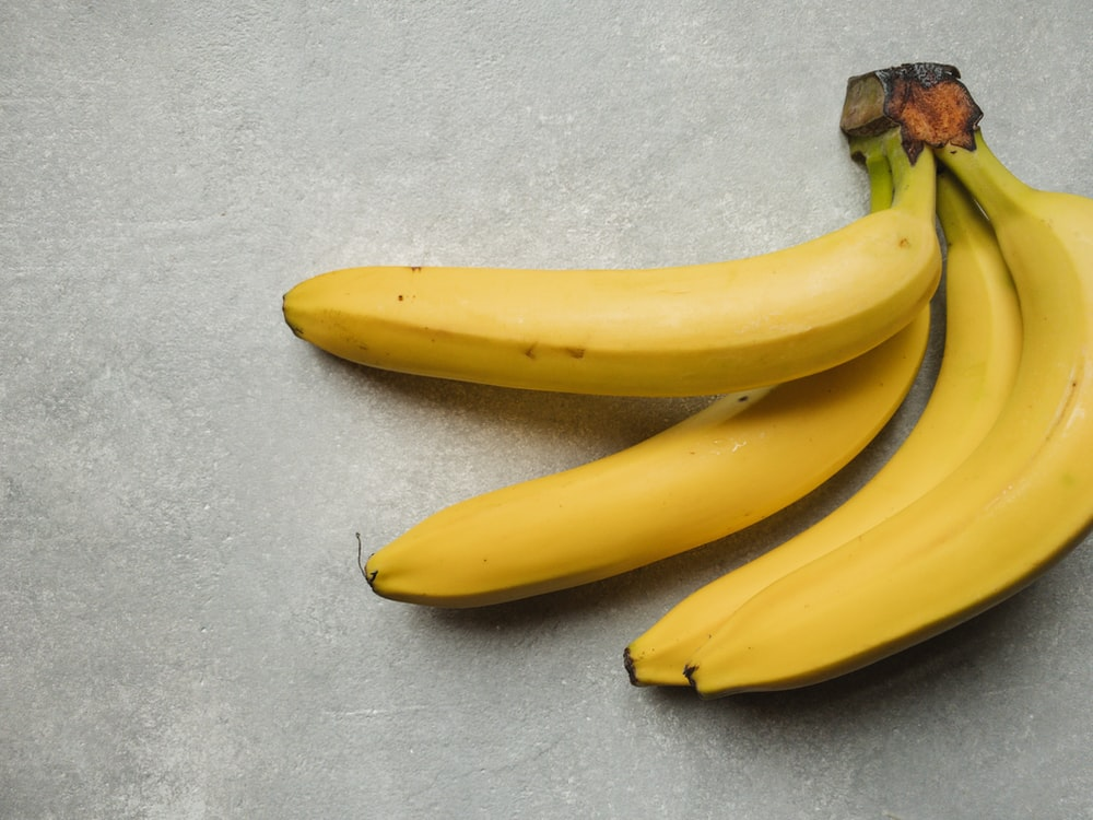 yellow banana fruit on gray table