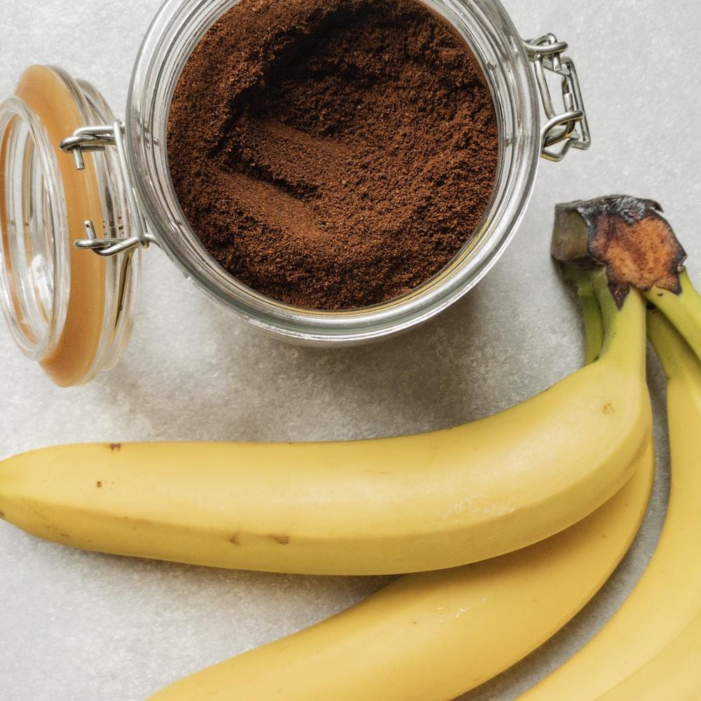 yellow banana fruit beside clear glass mug
