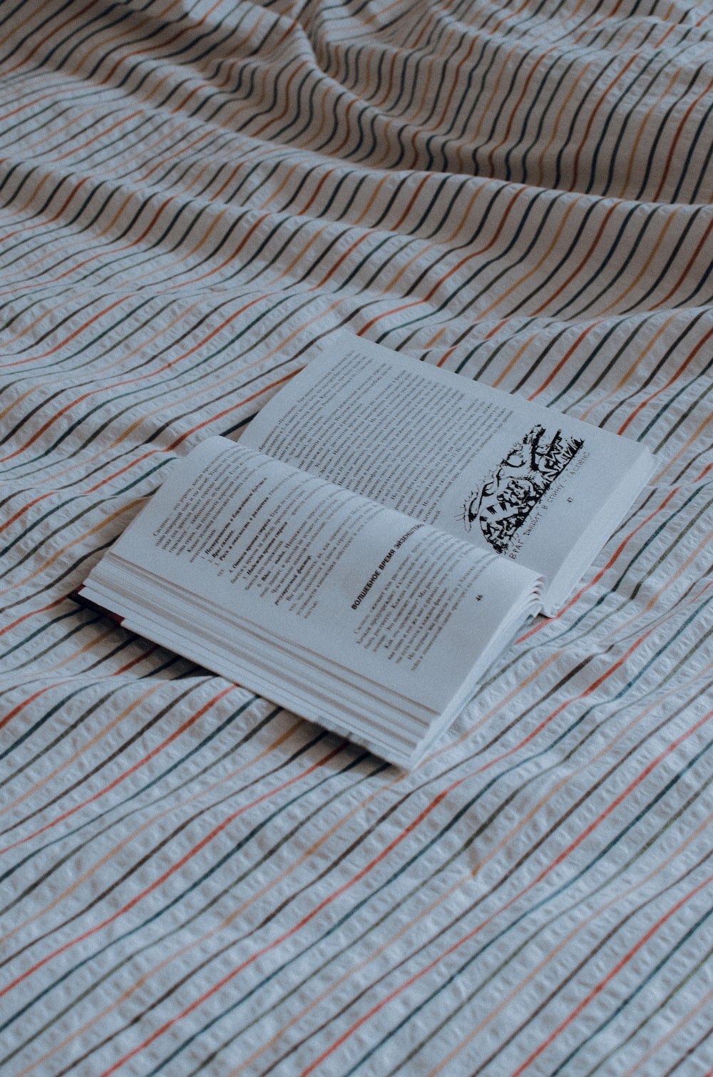 white paper on white and red textile
