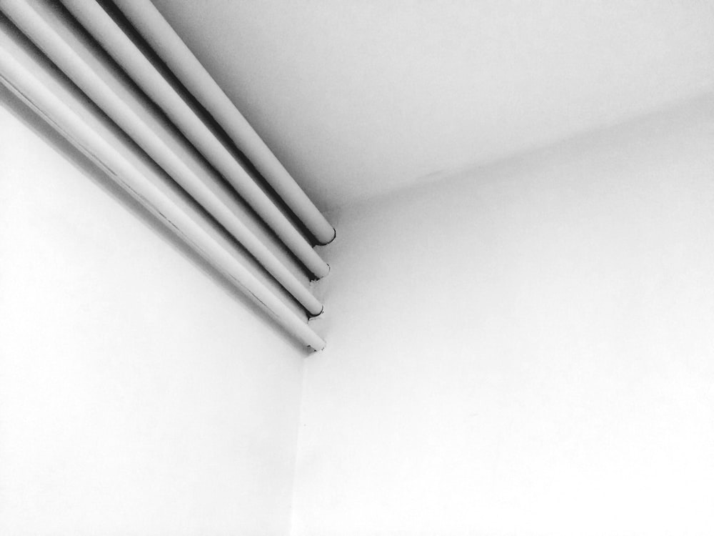 white and gray window blinds