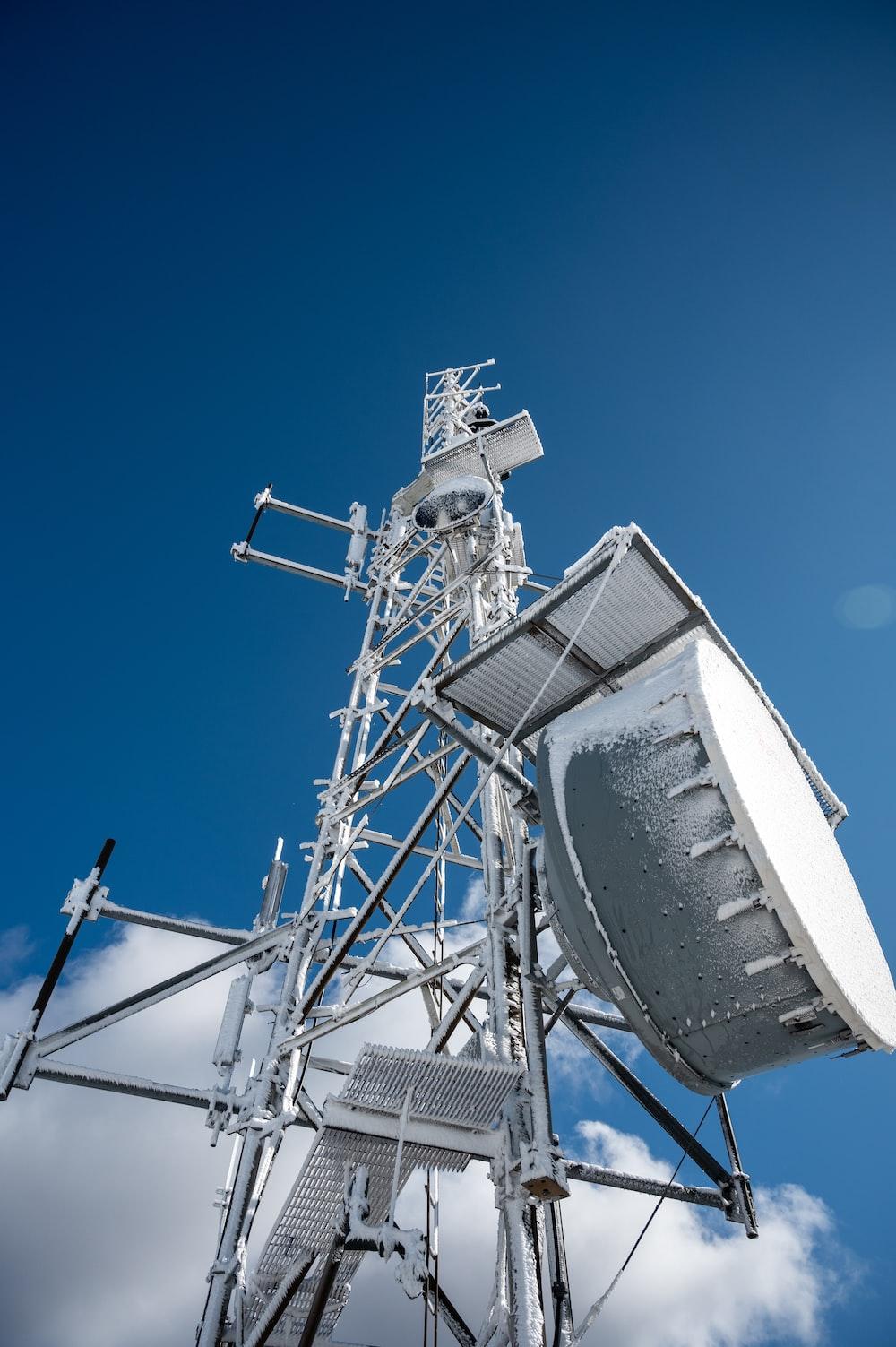 white and gray satellite under blue sky during daytime